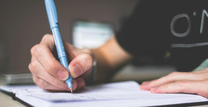 person-writing-journal | Rhonda Ware Solutions